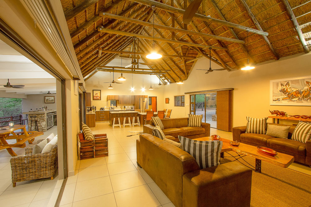 Kitchen Lounge area Inside Bush Lodge area lapa with a fire burning next to the Kruger National Park