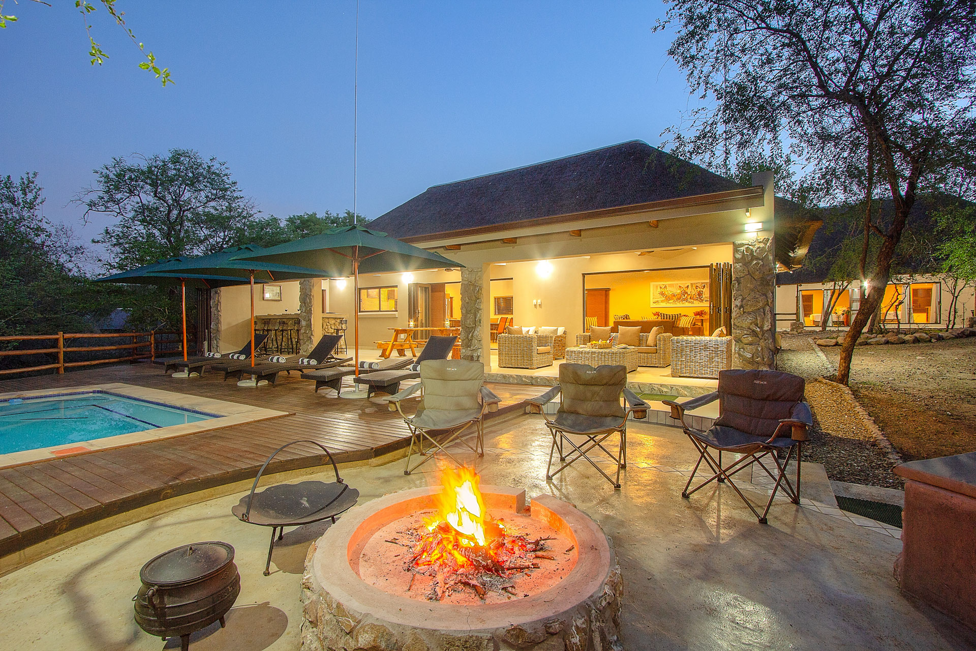 Outside Pool area lapa with a fire burning next to the Kruger National Park